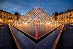 Majestic and beautiful in its symmetry, the pyramid that dominates the gateway of the Louvre at sunset.  Follow  me on Facebook Please visit my site giuseppetorre.co.uk