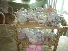 Hand painted tea cart of roses and ivy with my beautiful teapots.
