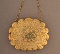 Mary Lincoln's gold evening purse, 1863. Her name and the year were engraved inside the ring.