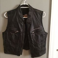 Awesome Harley leather vest- size medium Awesome Harley leather vest- size medium. Slightly cropped cut. Great condition. I'm only selling cause I'm WAY too busty for it. Harley-Davidson Jackets & Coats Vests
