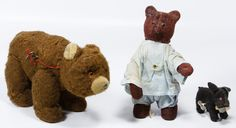 Lot 512: Key Wind Mechanical Bears and Dog; Three items including a brown bear that moves his head, a red bear with shoe button eyes that plays a violin or guitar and a small Japanese dog