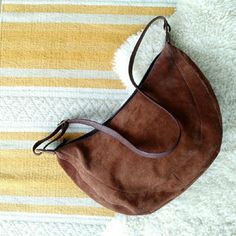 "Ganson Suede Hobo Crossbody Bag Chocolate Brown Suede Hobo Crossbody Bag from Ganson with gold-tone hardware. Two major pockets (one zip, one open). Zip pocket has one smaller zip pocket inside. 16""W x 9""T x 4""D. Strap drop is 9"" minimum to 18"" maximum, can be worn as a shoulder bag or crossbody. Real suede in very good used condition with minor wear on one side (third photo). Faux leather strap and details. Ganson Bags Crossbody Bags"