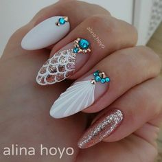 The almond nail is a beautiful shape that is currently trending in 2017. You don't have to grow your nail or wear long acrylic, because almond shape can make your finer look even longer. A classy style for almond nails is the glitter nail. Also nice with mermaid color featuring the same style of lip …
