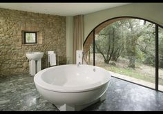 Scenic Bath Castello di Casole, Tuscany, Italy What's better than sinking into a soaking tub that measures six feet across? Doing so while enjoying views of Tuscan vineyards and oak forest. Interior Exterior, Interior Design, Beautiful Bathrooms, Small Bathrooms, Luxury Bathrooms, Luxury Real Estate, My Dream Home, Dream Homes, Future House