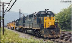 Chesapeake & Ohio GP35 #3582 leads a fellow GP40 and two Chessie General Electric units as all four run light through the once important terminal at Handley, West Virginia on May 29, 1982.
