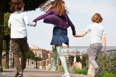 Stock Photo : Young boys and older sister marching through park, Province of Venice, Italy