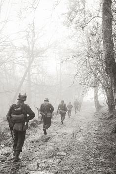 Into the Mist.    German grenadiers march through the eery early morning mists whilst on Patrol.