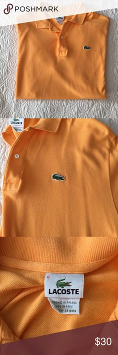 Mens Lacoste Polo Mens Lacoste polo in s light orange color that is perfect for summer! In great condition but has a small mark on the left chest that you can see in the pictures. It may even come off. Other than that it's in perfect shape! Lacoste Shirts Polos