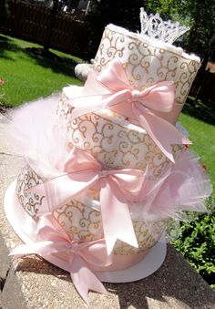Princess Diaper Cake - Light Pink Satin & Gold Damask Princess Crown Baby Girl Baby Shower Elegant Diaper Cake Centerpiece by DomesticDivaDesignz on Etsy https://www.etsy.com/listing/237846116/princess-diaper-cake-light-pink-satin