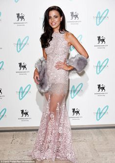 Stealing the spotlight: Sophia grabbed attention in a sheer lace dress which showed off her long legs
