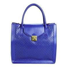 """Gerald bag in cobalt. Structured bag with perforation design in the front. It features dual top handles, a foldover flap with magnetic snap clouser, and adjustable removable shoulder strap. Bright silver tone hardware. The material imitates real leather. One interior pocket, one interior zip pocket.  Details: L 13"""", H 12"""", D 5-1/2"""", faux leather.  Please use only ✔OFFER  button for all price negotiations. I'll do a price drop⤵ for you for discounted shipping, if we agree about the price…"""