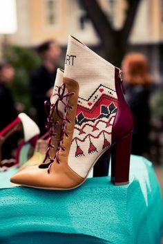 We Spent 24 Hours With Malone Souliers' Designers: woven fabric lace-up heeled boots during London Fashion Week | coveteur.com