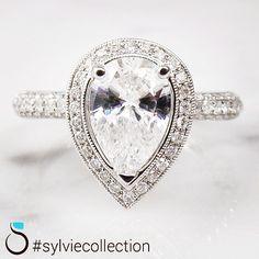 Vintage style with a pear shape! #sylviebrides #byawomanforawoman #getengagedwithSylvie #pearshape #halo #diamondband #sparkle #vintage