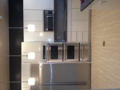 Moms kitchen. Glass backsplash tile wood patterned floor and Kosmus granite counters