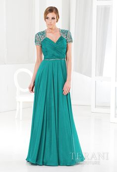 Shimmering chiffon evening gown with bolero-inspired embelished mesh shoulders and beaded belt, followed by a flowing a-line skirt