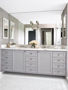 Master: Elegant bathroom features a gray dual sink vanity topped with statuary marble fitted with his and hers sinks and a full length and full height mirror lined with a 2 light antique nickel wall sconce alongside a mosaic marble tiled floor. Bathroom Mirror Design, Bathroom Renos, Bathroom Interior, Bathroom Cabinets, Bathroom Ideas, Bathroom Vanities, Vanity Design, Bath Ideas, Bathroom Furniture