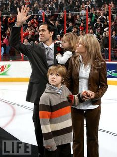 Eric Desjardins with his wife and children
