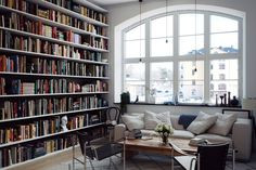 I love this room. Amazing home library.