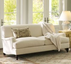 Carlisle Apartment Sofa, designed with a deep seat and low back for unparalleled comfort.