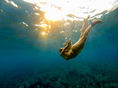 Alison Teal, enjoying a view of the sunset from beneath the sea in Hawaii. Taken on a GoPro.