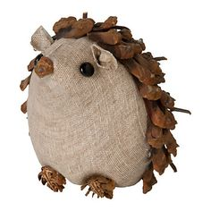 """Woodland Hedgehog    Set this curious critter among holiday greens on the mantel for an adorable addition to your seasonal décor.    - Pinecone, twig, fabric  - Imported    3.5""""H"""