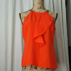 TOP Orange color with a adjustable leather around the neck. Perfect for Sprung/summer. Worthington  Tops Blouses