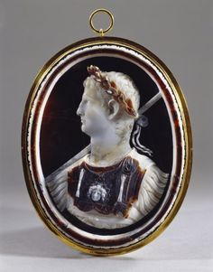 Emperor Claudius | Royal Collection Trust Creator:  Imperial Rome (place of production) Creation Date: Cameo: 43-5 AD; Mount ?17th c. Materials:  Sardonyx, multi-layered white and brown; glass backing with colouring, closed copper-gilt mount Provenance: Possibly Abraham Gorlaeus of Delft; from whom perhaps acquired by Henry, Prince of Wales (d. 1612); from whom inherited by Charles I when Prince of Wales;