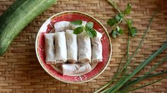 Male hand turn fresh Spring roll plate around, Vietnamese food, vintage style food concept footage