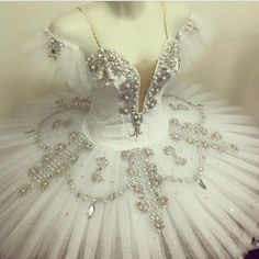 A stunning white pancake tutu to be used for the role of the Candide Fairy in the ballet The Sleeping Beauty, as well as for many other classical solos. The bodice features a very deep cut in the fron