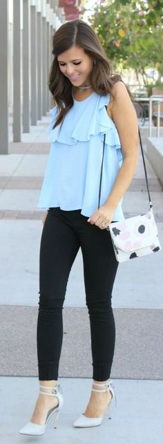 Love the look of a loose blouse and tight leggings! & those heels are…