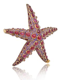 "René Boivin ""Starfish"" brooch, comprised of cabochon ruby collets set amongst pavé-set baguette and round faceted amethysts, embodies the natural aesthetic for which Maison René Boivin is known.  Recently a part of the Stephen Russell collection, this realistic brooch belonged to the legendary Standard Oil heiress Millicent Rogers  http://www.jewelsdujour.com/wp-content/uploads/2013/03/CJINV9665sideactual.jpg"
