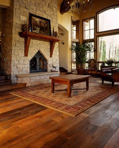 Mesmerizing Different Types Of Wood Floors: Remarkable Flooring Decoration Ideas Antique Wood Flooring Style Living Room Stone Fireplace Large Windows Antique Chandelier Wood Coffe Table Patterned Carpet Indoor Plant Cozy Single Chair.jpg ~ dropddesign.com Flooring Inspiration