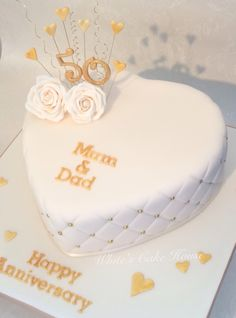 Heart shaped golden anniversary cake                              …