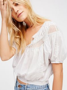 Dream Girl Crop Top | Lightweight and semi-sheer peasant top in a cropped silhouette with dotted sheer mesh trim. Oversized fit with dolman style sleeves and an elastic waistband.