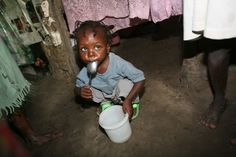 A young Haitian girl savors every last bite of rice in her pail. In Haiti, more than half of the population -- including two-thirds of children -- suffers from malnutrition...