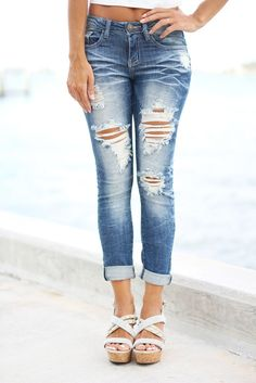 BACK IN STOCK! Loving these awesome Super Destroyed Capri Jeans! Pair with any of our solid blouses or printed tops for a super fashionable look. Get these must have jeans! - 97% Cotton - 3% Spandex -