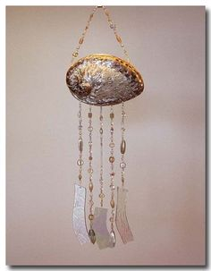 Ocean Gem Wind Chimes634 x 814 | 58.7 KB | talquin-treasures.com  DIY Windchime   this could be made with necklaces and clam shell  awesome