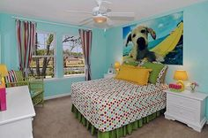 Great surfing themed room in The Kittery model in Jacksonville, Florida! Love the poster of the dog on the surf board!