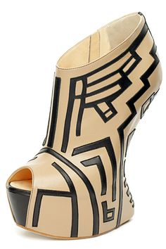 """i always like it when they tell you that it is a """"heel Less Wege. """"Really?""""  Giuseppe Zanotti Tribal Heel Less Wedges (Spring 2012)."""