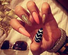 Sharp pointed tips with the accents of gold, white, black, and pink! :) These are some glamour nails!