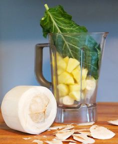 Green Pina Colada   1 young Thai coconut ( or a 13.5-oz can of coconut milk)  1 banana  1 16-ounce bag frozen organic pineapple (unsweetened)  1/2 bunch of collard greens, stems removed