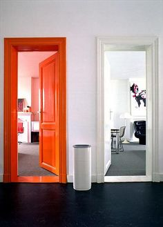 orange door, black floor