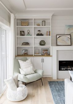 Inside a Bright White Home Filled With Coastal Character Storage Solutions // Coastal living room with fireplace and built ins Coastal Bedrooms, Coastal Living Rooms, Home Living Room, Living Room Designs, Living Room Furniture, Living Room Decor, Coastal Cottage, Coastal Homes, Coastal Style