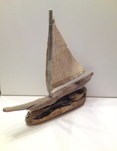 Cute!  Chios Driftwood sailboat with burlap sail ready to by AMMOUDIA. $35.00, via Etsy.