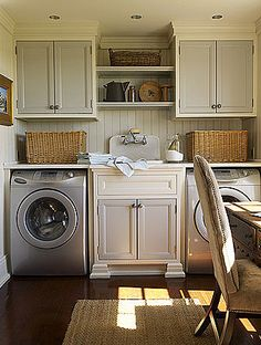 love this laundry room... everything looks like funiture, tons of storage and an office. perfect.