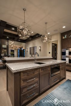 Kitchen Island with amazing lighting in Utah.  Home built by Cameo Homes Inc.