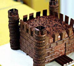 Its a chocolate castle. 2 square cakes on top of one another with icing, . cookies for the towers,( a wee bit of icing in between cookies for gluing them together ) chocolate bar pieces for brick . kit kat chocolate slab for Drawbridge. Chocolate Frosting, Chocolate Cookies, Vanilla Cookies, Torta Chocolate, Butterscotch Cookies, Making Chocolate, Chocolate Biscuits, Cake Cookies, Cupcake Cakes