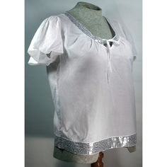 White blouse with silver sequins White with silver sequins all around collar and bottom of blouse. V-neck with a tie front; cap sleeve. 100% cotton. Part of Lane Bryant's Venezia line. Beautiful blouse! Lane Bryant Tops Blouses
