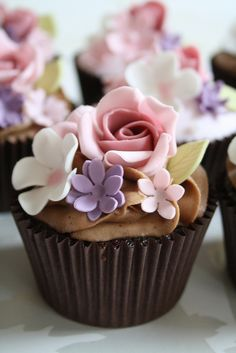 Chocolate cupcake decoration ideas - you can also put no buttercream icing on the top of the cupcake... just the gumpaste flowers ... this cuts the calories and the sweetness without losing elegance :-)