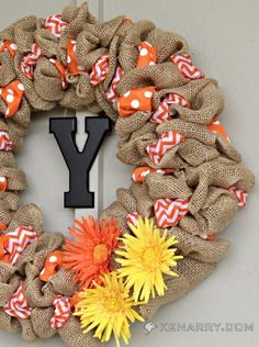 Break out the burlap and create this fun and summery wreath for your door that looks good even in the fall!